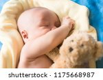 cute baby laying on bed.newborn ... | Shutterstock . vector #1175668987