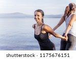 young attractive smiling women... | Shutterstock . vector #1175676151