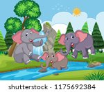 elephants playing in the water... | Shutterstock .eps vector #1175692384