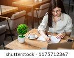 an asian girl is freelancer... | Shutterstock . vector #1175712367