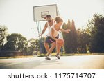 young couple playing basketball.... | Shutterstock . vector #1175714707
