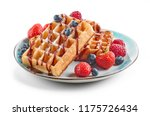plate of waffles decorated with ... | Shutterstock . vector #1175726434