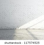 empty white brick room and sunlight - stock photo