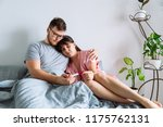 sad couple in bed looking at... | Shutterstock . vector #1175762131