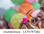 old man blows bubbles as he... | Shutterstock . vector #1175797381