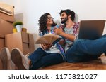 happy young couple moving into... | Shutterstock . vector #1175821027