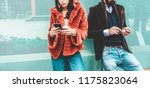 Stock photo trendy influencers people using smartphone social media app young fashion couple watching story 1175823064