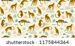 Stock vector vestor seamless pattern with leopards and tropical leaves trendy style 1175844364