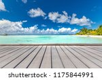 wood table top on blurred blue... | Shutterstock . vector #1175844991