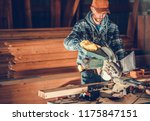 Woodwork Contractor Job. Caucasian Worker Cutting Wood Planks Using Circular Wood Saw. Construction Industry. - stock photo