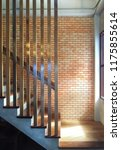 wooden staircase with red brick ... | Shutterstock . vector #1175855614