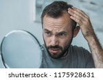 upset middle aged man with... | Shutterstock . vector #1175928631