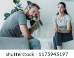 upset middle aged man sitting... | Shutterstock . vector #1175945197