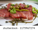 bruschetta with prosciutt | Shutterstock . vector #1175967274