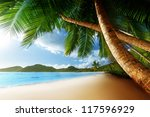 Stock photo sunset on beach anse takamaka of mahe island seychelles 117596929