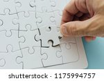 missing piece of the puzzle.... | Shutterstock . vector #1175994757