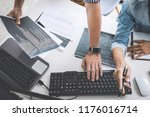 programmers cooperating at... | Shutterstock . vector #1176016714