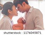 mother holding her little cute...   Shutterstock . vector #1176045871