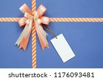decorative bow with blank tag... | Shutterstock . vector #1176093481