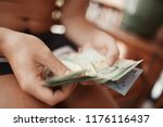 money in the hands of a tourist ... | Shutterstock . vector #1176116437