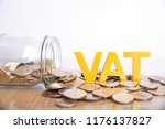 Small photo of Vat Concept.Word vat put on coins and glass bottles with coins inside on white background.