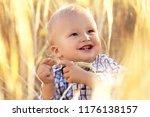cute little baby in wheat field ... | Shutterstock . vector #1176138157