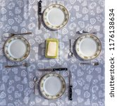 wrong table set  dishes  four... | Shutterstock . vector #1176138634