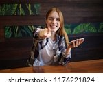 beautiful girl with a phone...   Shutterstock . vector #1176221824
