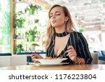 seductive woman eating pasta ... | Shutterstock . vector #1176223804