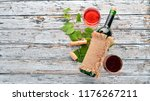 red wine in a bottle with a... | Shutterstock . vector #1176267211