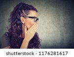 young woman covering mouth... | Shutterstock . vector #1176281617