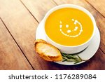 bowl of vegetable yellow soup... | Shutterstock . vector #1176289084