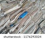 waste paper. tilt close up... | Shutterstock . vector #1176292024