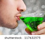 man drinks green alcohol... | Shutterstock . vector #117632575