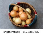 small basket with a onions on a ...
