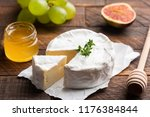 brie or camembert cheese with... | Shutterstock . vector #1176384844