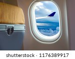 airplane wing on airplane... | Shutterstock . vector #1176389917