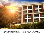 white hotel building with palm... | Shutterstock . vector #1176400957
