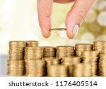 golden coins stacks on a... | Shutterstock . vector #1176405514