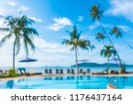 Abstract blur and defocused outdoor swimming pool in luxury hotel and resort for holiday travel and vacation