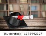 graduation mortarboard on  book ... | Shutterstock . vector #1176442327