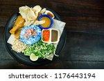 nasi kerabu with chicken and... | Shutterstock . vector #1176443194