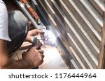 closeup of worker welding auto... | Shutterstock . vector #1176444964
