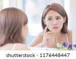 woman look mirrior feel upset... | Shutterstock . vector #1176448447