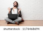 young man sitting on the floor... | Shutterstock . vector #1176468694