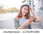 asia woman using with smart... | Shutterstock . vector #1176491584
