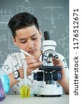 vietnamese schoolboy using... | Shutterstock . vector #1176512671