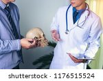 doctor is holding a human skull ... | Shutterstock . vector #1176515524