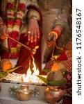 indian couple fire flame ritual ... | Shutterstock . vector #1176548167