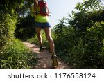 young woman trail runner... | Shutterstock . vector #1176558124